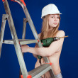 Topless girl near scaling-ladder — Stock Photo