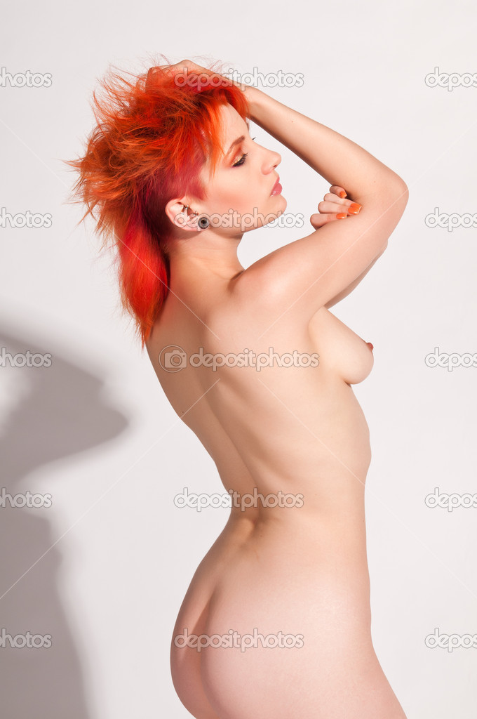 Pale slender nude redhead with dramatic hair and makeup — Stock Photo #6926252