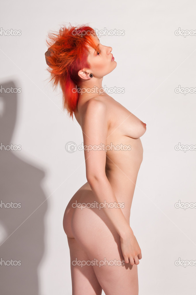 Pale slender nude redhead with dramatic hair and makeup — Stock Photo #6926257