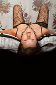 Seductive young girl in black lingerie — Stock Photo